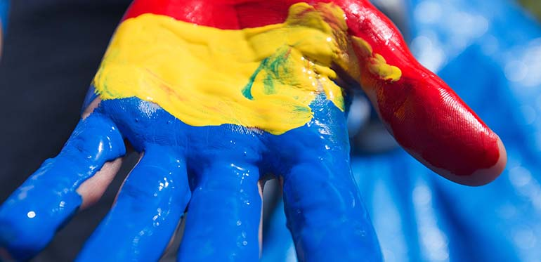 Queen's tri colours in paint on a hand