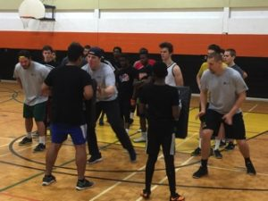 Allen Champagne (middle) teaching proper blocking technique with Sherbrooke Varsity Football players in Sherbrooke, QC